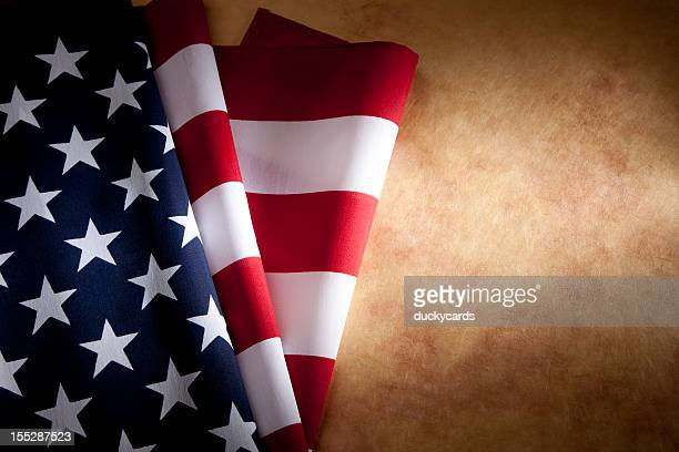 usa american flag on parchment paper copyspace - folded flag stock pictures, royalty-free photos & images