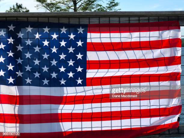 american flag on wire fence - memorial day background stock pictures, royalty-free photos & images
