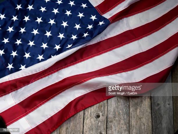 american flag on wooden table - stars and stripes stock pictures, royalty-free photos & images