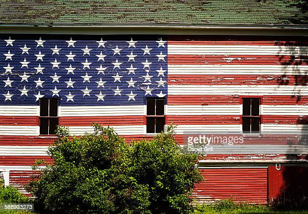 American flag painted on facade of barn
