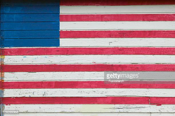 American flag painted on side of house