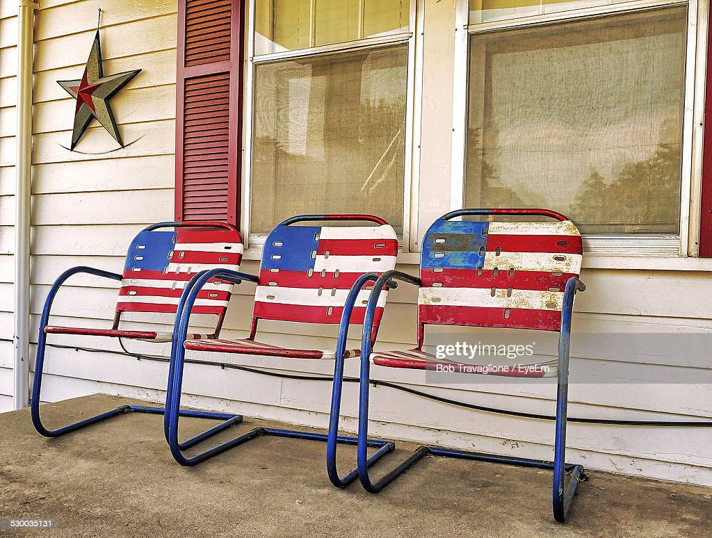 American Flag Painting On Three Chairs Standing On Porch Stock Photo |  Getty Images