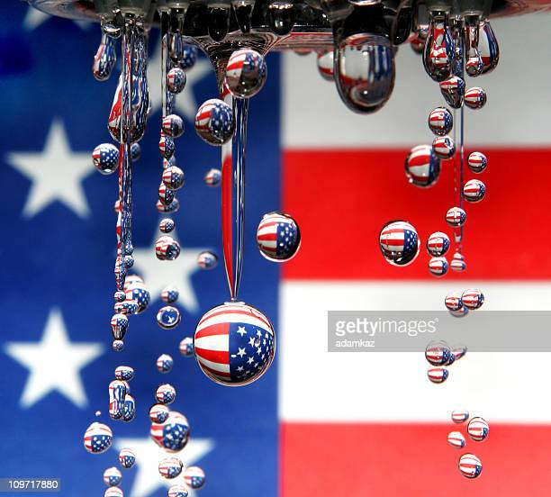 american flag reflecting in water droplets - 4th stock pictures, royalty-free photos & images