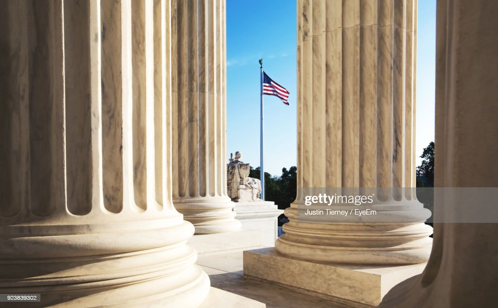 American Flag Seen Through Columns : Stock Photo