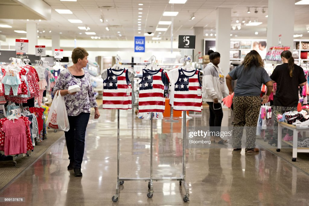 American flag themed clothing hangs on a rack inside a J.C. Penney Co. store in Peoria, Illinois, U.S., on Saturday, May 12, 2018. J.C. Penney Co. is scheduled to release earnings figures on May 17. Photographer: Daniel Acker/Bloomberg via Getty Images