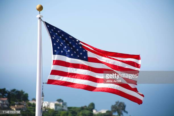 american flag, us flag, usa flag, united states of america flag flying in sky - veterans day background stock photos and pictures