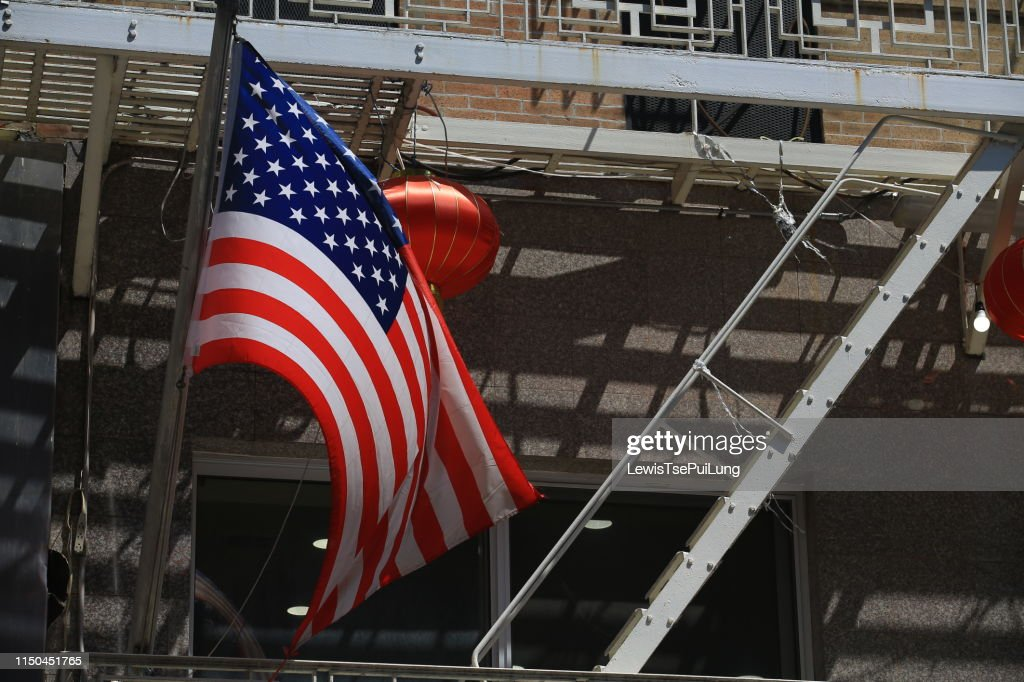 american flag wave in the city : Stock Photo