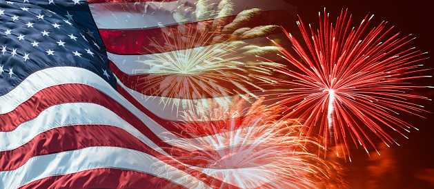 american flag waving for a national holiday with fireworks 474522956