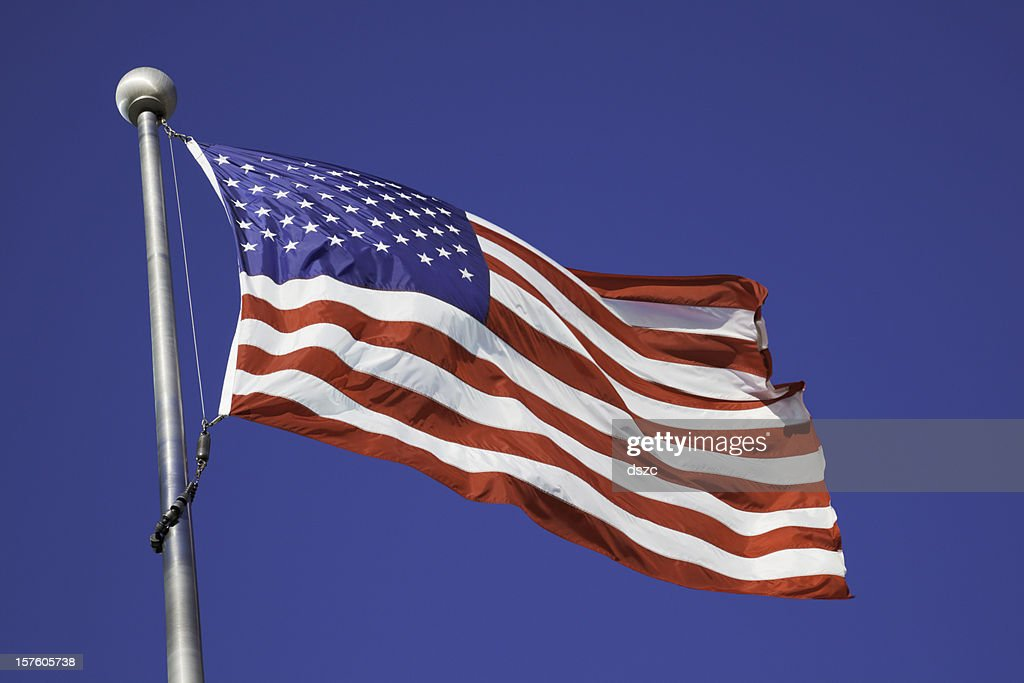 American Flag Waving In Breeze On Pole Stock Photo Getty