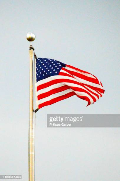 american flag waving in the wind - flagpole stock pictures, royalty-free photos & images