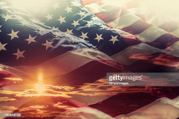 american flag waving in the windat sunset - american symbol of 4th of july independence day democracy and patriotism. - national landmark stock pictures, royalty-free photos & images