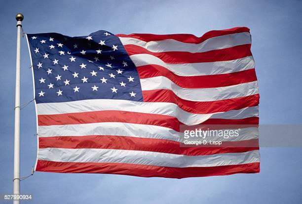 american flag waving in wind - 旗棒 ストックフォトと画像