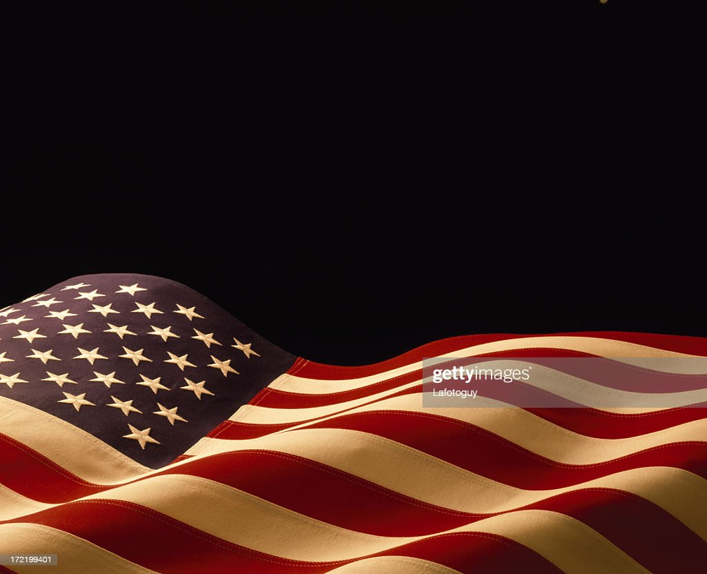 american flag waving on a black background stock photo