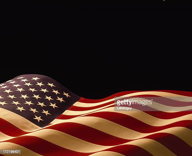 American flag waving on a black background