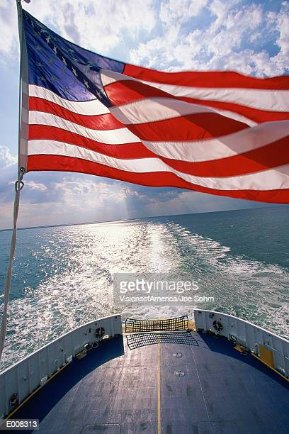 american flag waving on ship - american flag ocean stock pictures, royalty-free photos & images