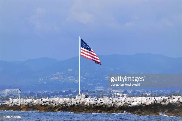 american flag waving - flagpole sitting stock photos and pictures