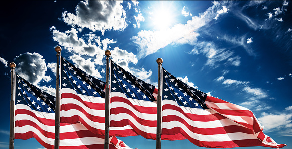 american flags against the sky for the memorial day 1149832104