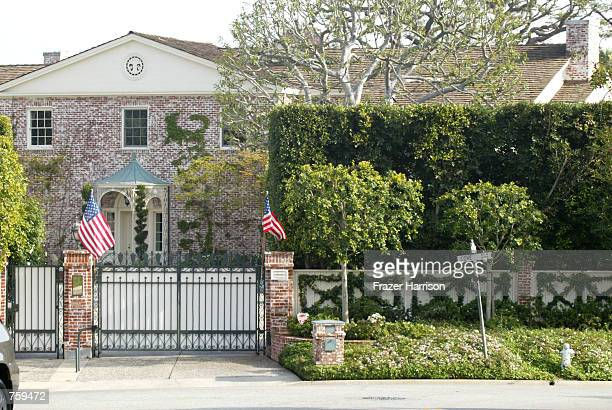 American flags are displayed in front of entertainer Ed McMahon's home April 10 2002 in Beverly Hills CA