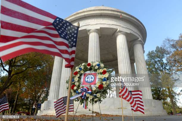 American flags are on display at the World War I Memorial to honor the 499 fallen DC area World War I veterans on November 11 2016 in Washington DC /...