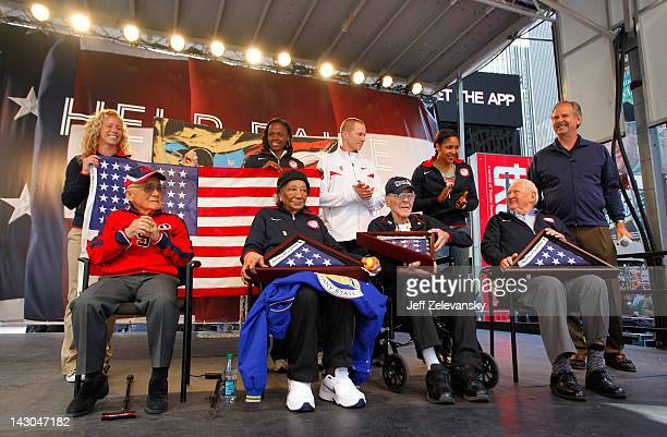 American flags are presented to 1948 Olympic athletes Dr Sammy Lee Alice Coachman Mal Whitfield and Ray Lumpp during the Team USA Road to London 100...