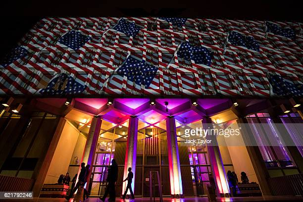 American flags are projected on to the United States Embassy during an election night party on November 8 2016 in London England Americans have gone...
