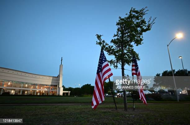 American flags are seen in front of the Fountain of Praise church where services will be held for George Floyd on June 8 2020 in Houston Texas...