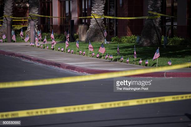 American flags are seen lining the conference center at the Inland Regional Center after South Waterman Ave in front of the Inland Regional Center...