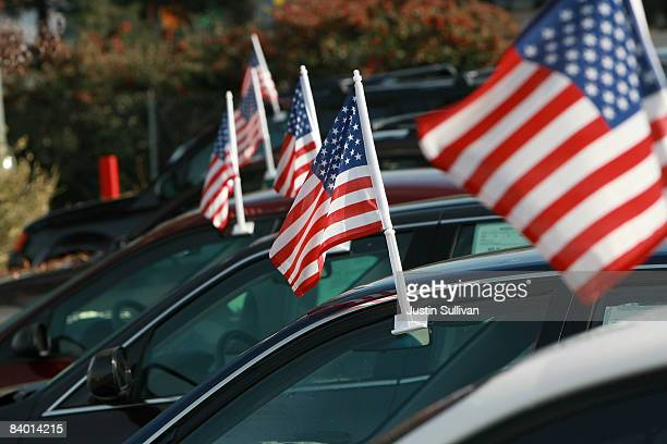 American flags are seen on cars for sale at Santa Rosa Chevrolet December 12 2008 in Santa Rosa California Auto dealerships continue to see a sharp...
