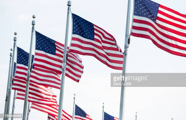 American flags are seen on the National Mall before the Salute to America Fourth of July event with US President Donald Trump at the Lincoln Memorial...