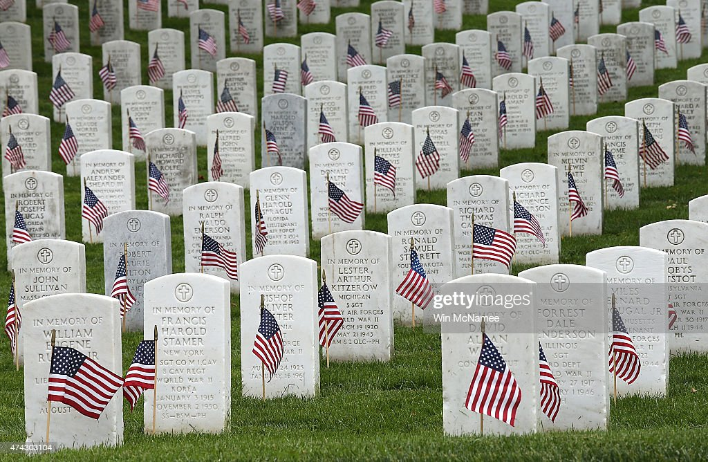 American flags are shown after being placed by members of the 3rd U.S. Infantry Regiment at the graves of U.S. soldiers buried at Arlington National Cemetery, in preparation for Memorial Day May 21, 2015 in Arlington, Virginia. 'Flags-In' has become an annual ceremony since the 3rd U.S. Infantry Regiment (The Old Guard) was designated to be an Army's official ceremonial unit in 1948