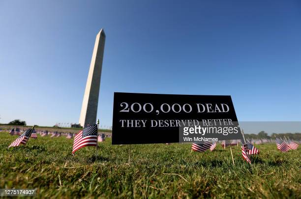 American flags at a COVID Memorial Project installation of 20,000 flags are shown on the National Mall as the United States crosses the 200,000 lives...