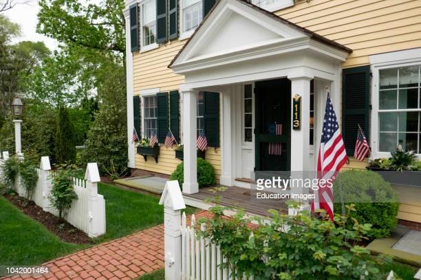 American flags displayed on a house in Edgartown Marthas Vineyard Massachusetts