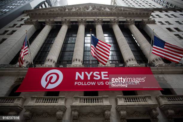 American flags fly above Pinterest Inc signage outside the New York Stock Exchange in New York US on Friday Feb 9 2018 The convulsions rocking US...