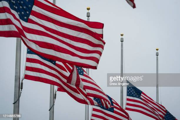 American flags fly at half-staff near the Washington Monument on the National Mall, May 22, 2020 in Washington, DC. President Donald Trump has...