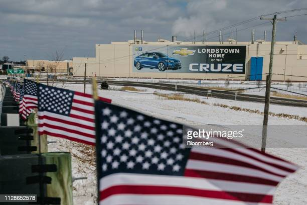 American flags fly in front of the General Motors Co Lordstown production plant complex in Lordstown Ohio US on Monday March 4 2019 The United Auto...