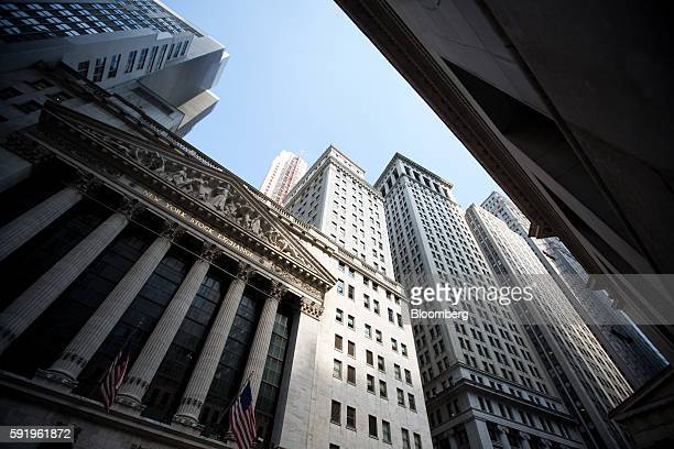 American flags fly outside The New York Stock Exchange in New York US on Friday Aug 19 2016 US stocks slipped for the first time in three days with a...