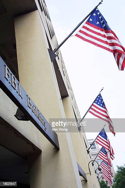 American flags fly over the Federal Bureau of Investigation building July 18 2001 in Washington D C The agency announced on that 449 of its weapons...