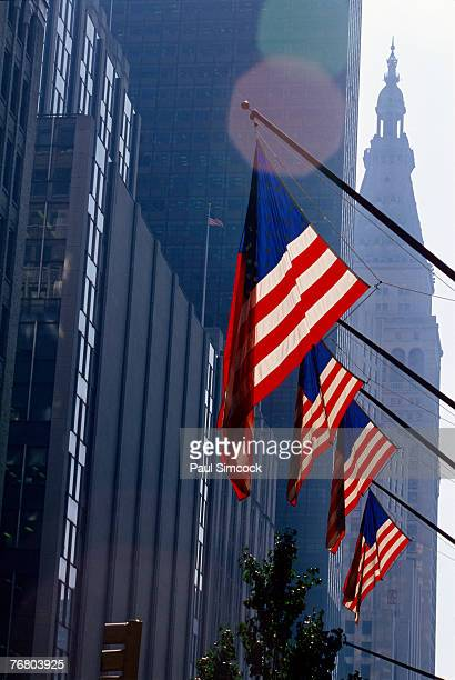 American flags flying from building
