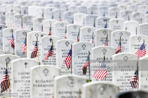 American flags have been placed next to the headstones in Arlington National Cemetery in observance of Memorial Day on May 31, 2021 in Arlington,...