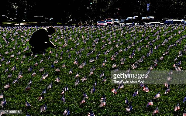 American flags have been planted on a grassy area of the Mall each of them represents a veteran or a service member who died by suicide in 2018 so...