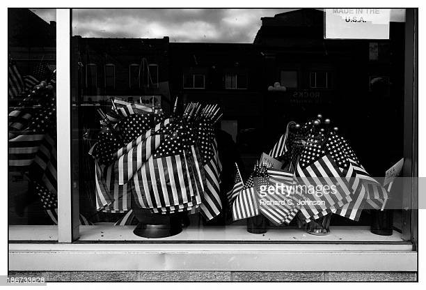 CONTENT] American flags made in the USA in shop window display