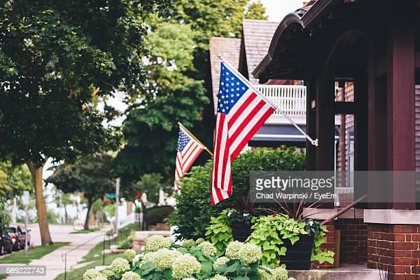 american flags on houses - milwaukee stock pictures, royalty-free photos & images