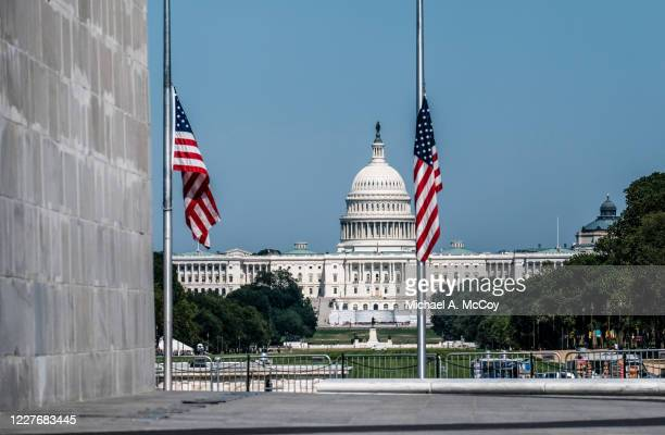 American flags outside of the Washington Monument lowered to half staff to honor the life of Rep John Lewis on July 18, 2020 in Washington, DC. John...