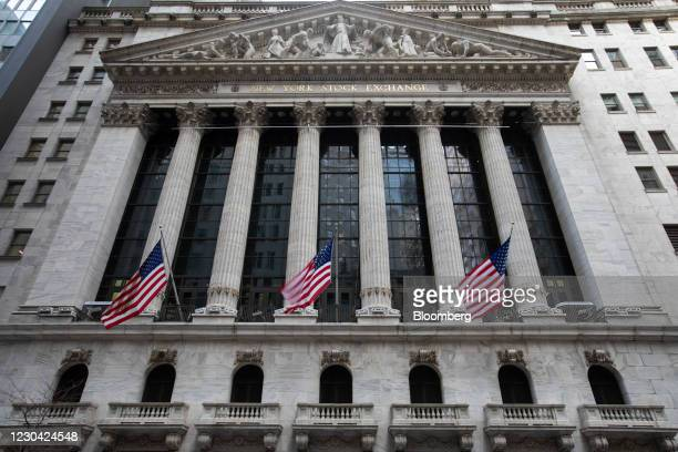 American flags outside the New York Stock Exchange in New York, U.S., on Monday, Jan. 4, 2021. In a historic year that marked a rapid plunge into...
