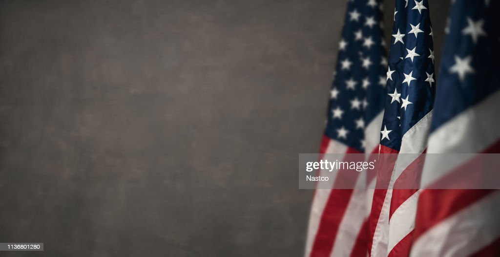 American flags over gray wal with copy space : Stock Photo