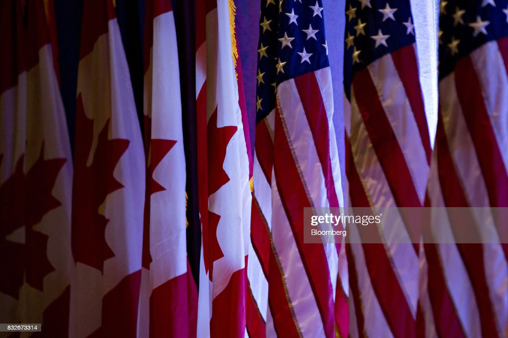 American flags, right, stand next to Canadian flags ahead of the first round of North American Free Trade Agreement (NAFTA) renegotiations in Washington, D.C., U.S., on Wednesday, Aug. 16, 2017. Canada and Mexico largely want to defend the advantages they have enjoyed under the two-decade-old Nafta deal, keep it free of tariffs and broaden it to new industries. President Donald Trump has called Nafta the worst trade pact in history and promised to fix it through negotiations or withdraw. Photographer: Andrew Harrer/Bloomberg via Getty Images