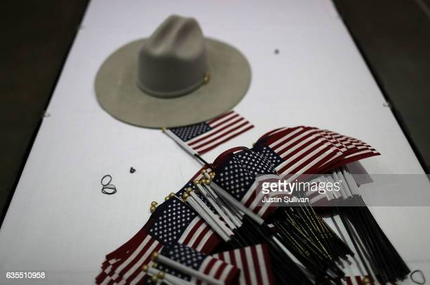 American flags sit on a table during a naturalization ceremony held by US Citizenship and Immigration Services at the Los Angeles Convention Center...