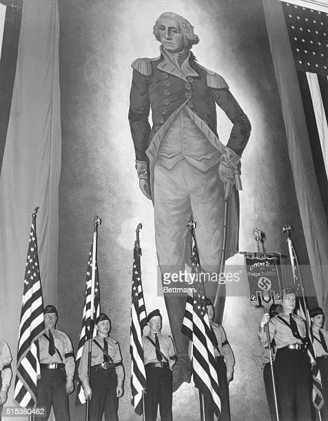 American Flags, Swastika and Washington. New York: A color guard holding American Flags and a banner, inscribed with the Nazi Swastika stands before...