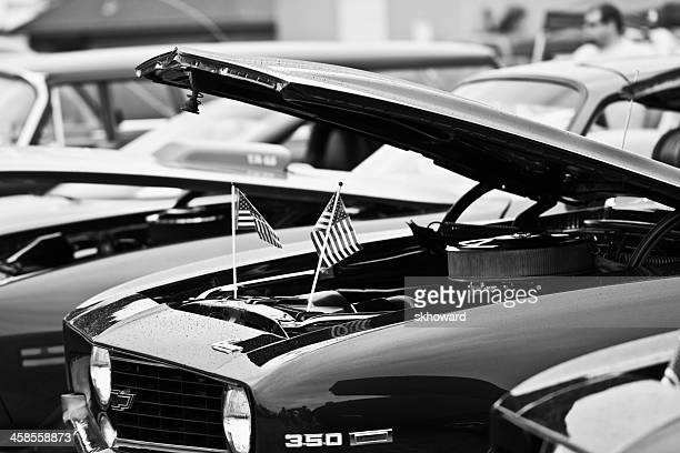 american flags under hood of chevrolet camaro - camaro stock photos and pictures