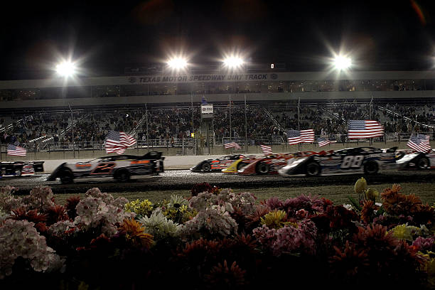American flags wave as Super Late models prepare to race in the Texas World Dirt Track